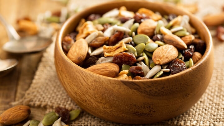 Nuts and dry fruits in wooden bowl