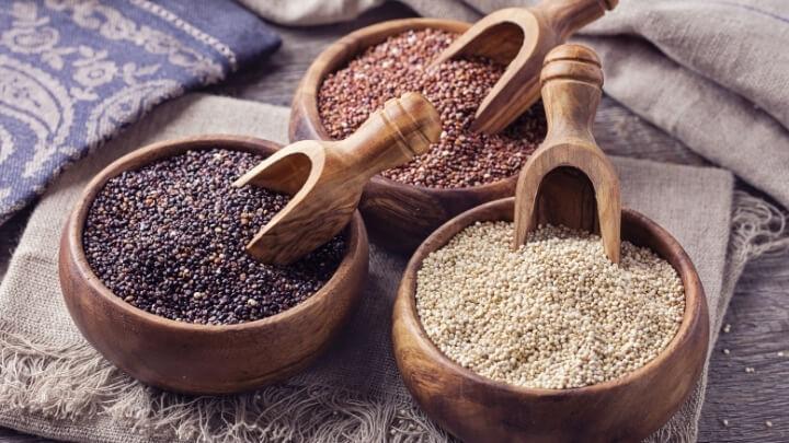Tri-color quinoa in separate wood bowls