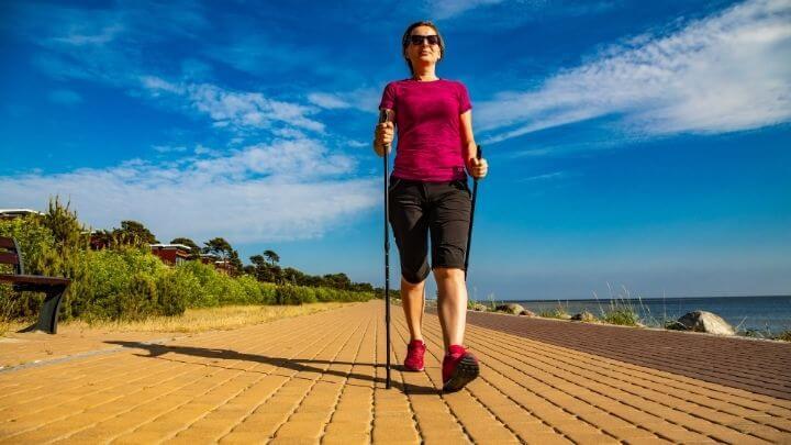 Healthy middle aged woman briskly walking
