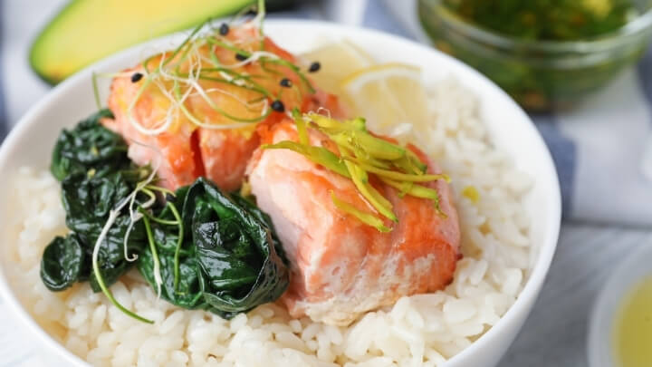 Baked salmon and spinach over rice