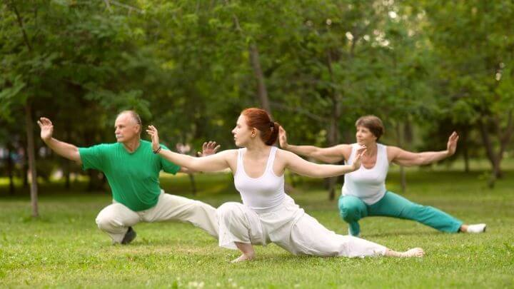 People doing tai chi in the park