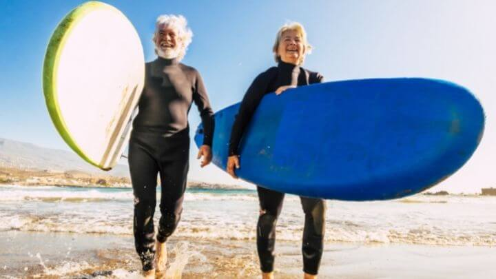 Elderly surfer couples at the beach