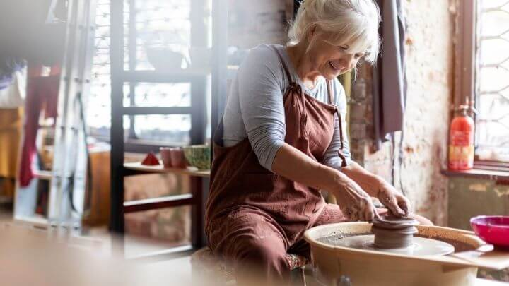 Healthy older woman working at her studio