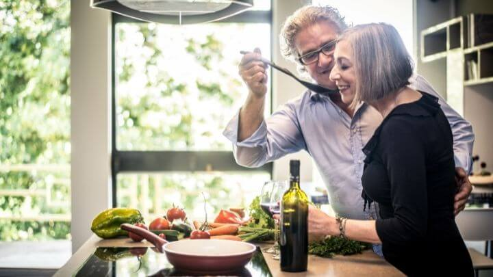 A couple cooking a healthy meal at home