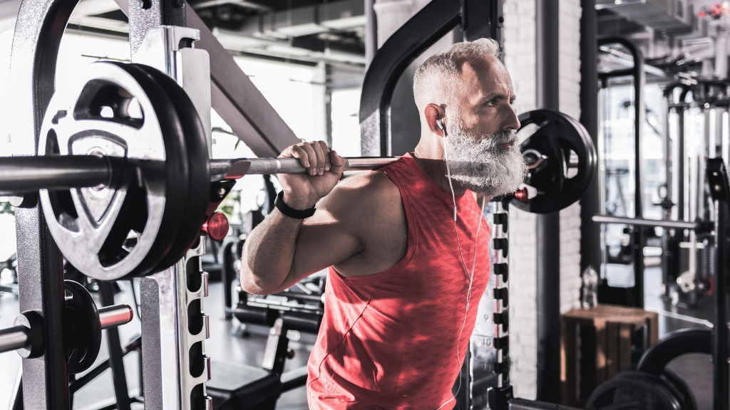 A middle aged man strength training