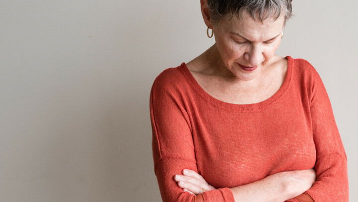 A worried senior woman