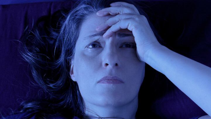 A woman cannot sleep because of stress