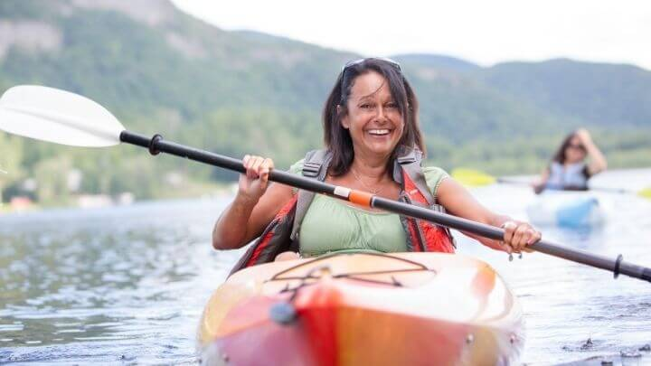 A middle aged woman on a kayak