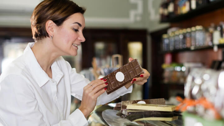 Woman choosing chocolate at the store