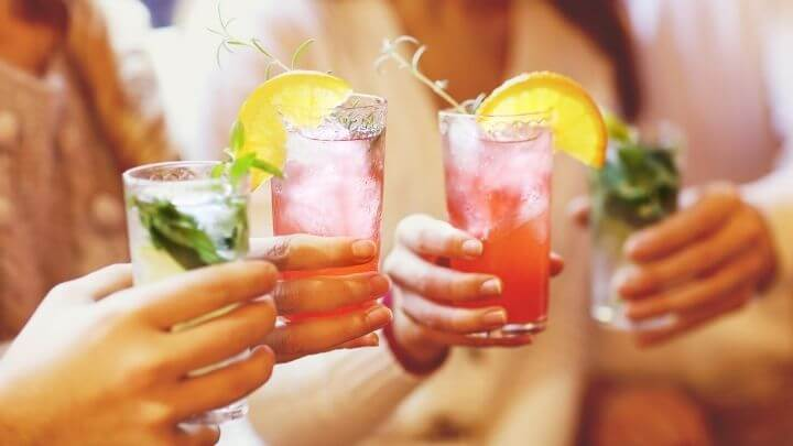 Women cheering with cocktails