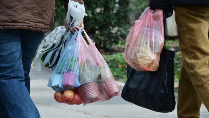 Shoppers carrying plastic bags