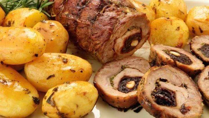 Stuffed pork roast with roasted rosemary potatoes