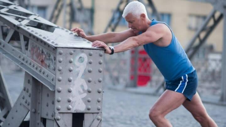 Older man stretching before jogging