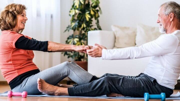 Older couple working out at home