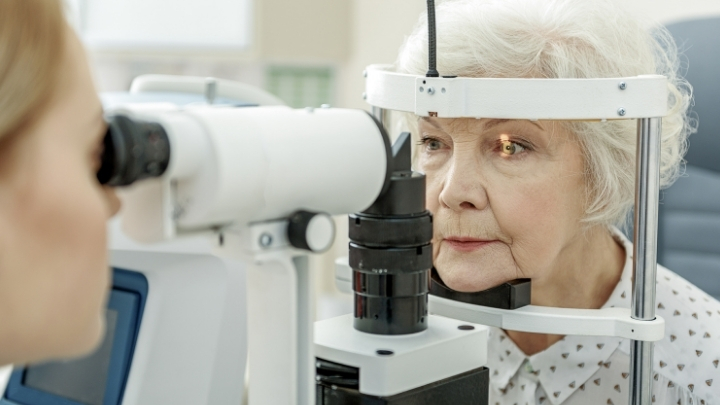 Senior woman getting her eyes checked