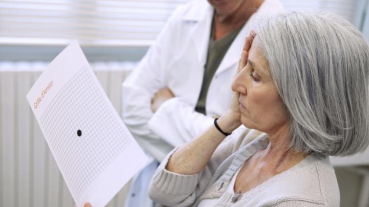 Woman taking Amsler grid eye test