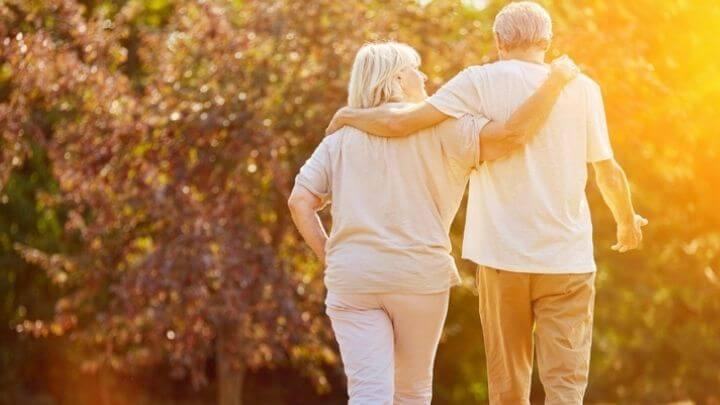 A senior couple taking a walk at sunset
