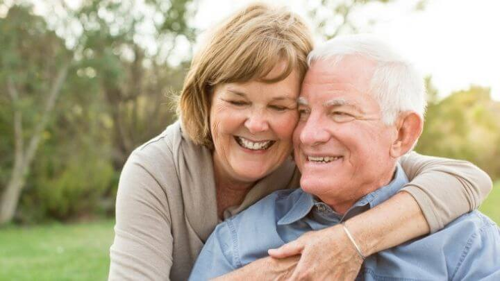 Older couple embracing each other