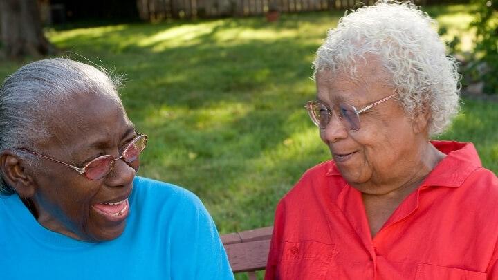 2 elderly ladies laughing