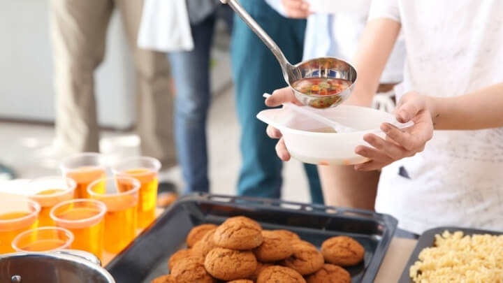 Homeless people being served food