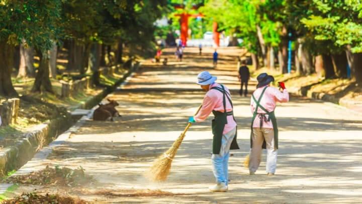 Volunteers sweeping the streets