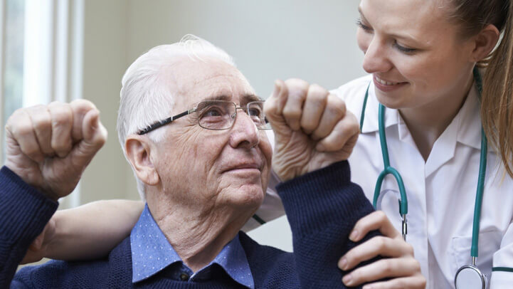 A doctor helping a patient recovering from stroke