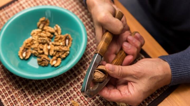 Man cracking walnuts open
