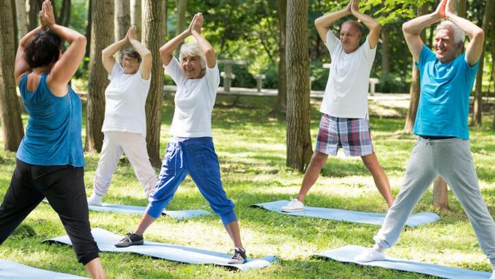 Seniors doing exercise in the park