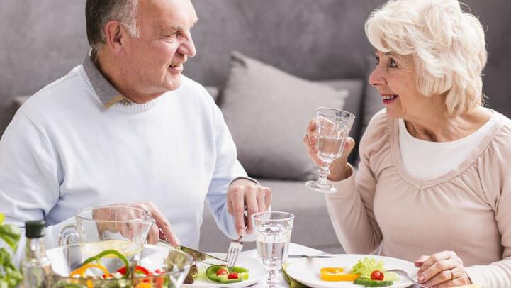 A senior couple having dinner