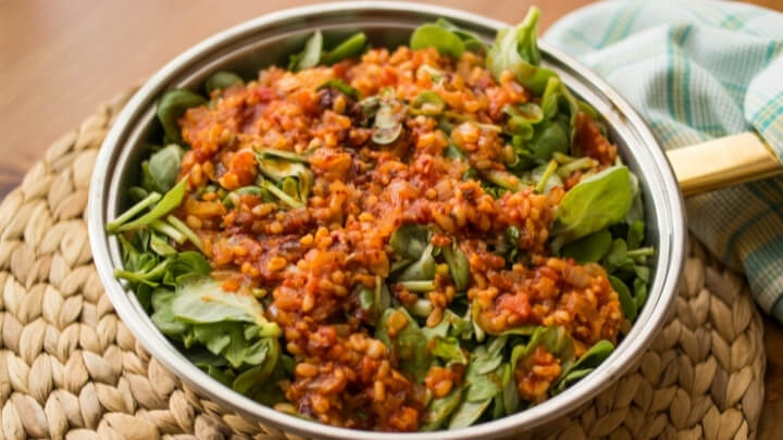 Purslane food with tomato sauce in a pan