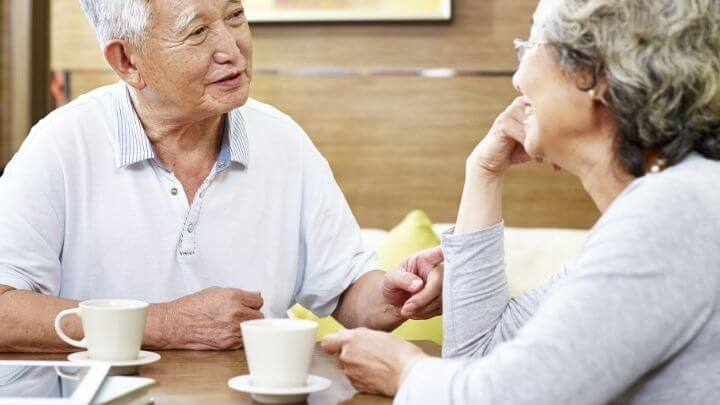 An elderly couple having tea
