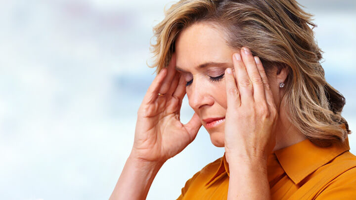 A middle aged woman with headache