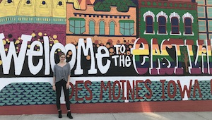 Intern Emi standing in front of mural in east village