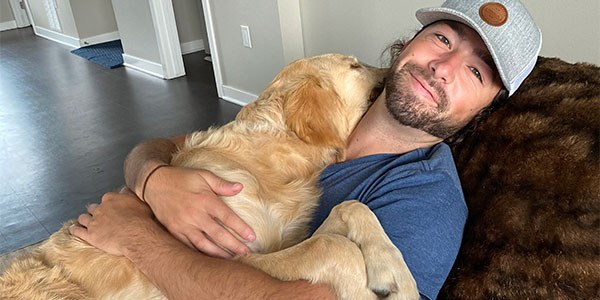 Two Rivers Associate Kyle Hanson with Willie the Golden Retriever