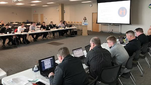 Group of sales team members participating in in-person LinkedIn training