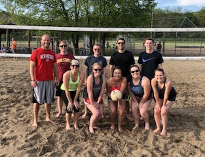 Sand volleyball team photo in front of the net