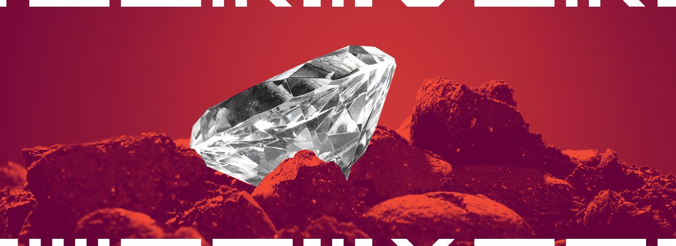 Image of a polished diamond sitting in coal