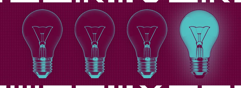 Four light bulbs with one illuminated