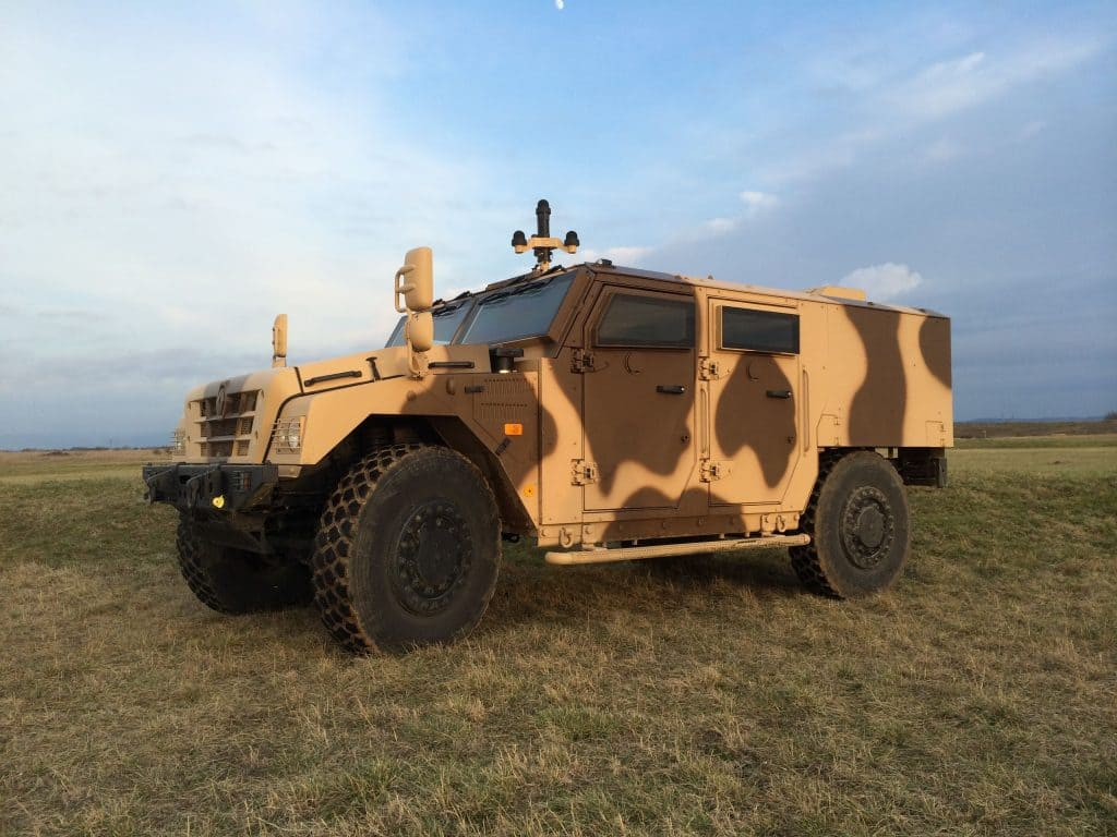 Armored vehicle equipped with acoustic threat detection device