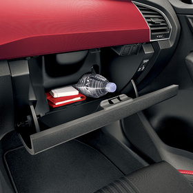 Bottle holder in glove compartment