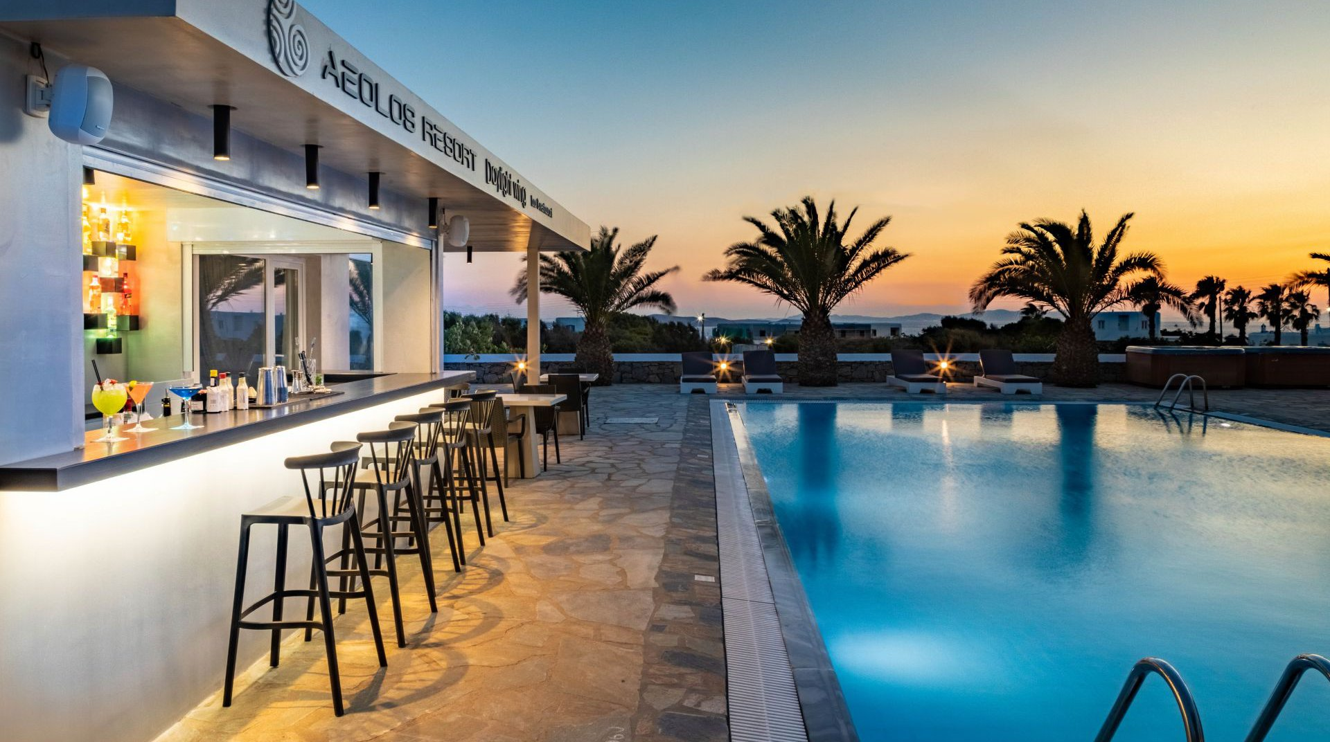 The pool bar of the Daylight Wing during the night with the pool and the sunbeds