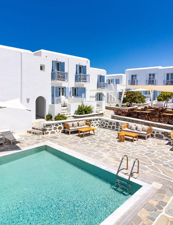 Main Section from the air with the pool, the sunbeds, the outdoors sofas and the restaurant