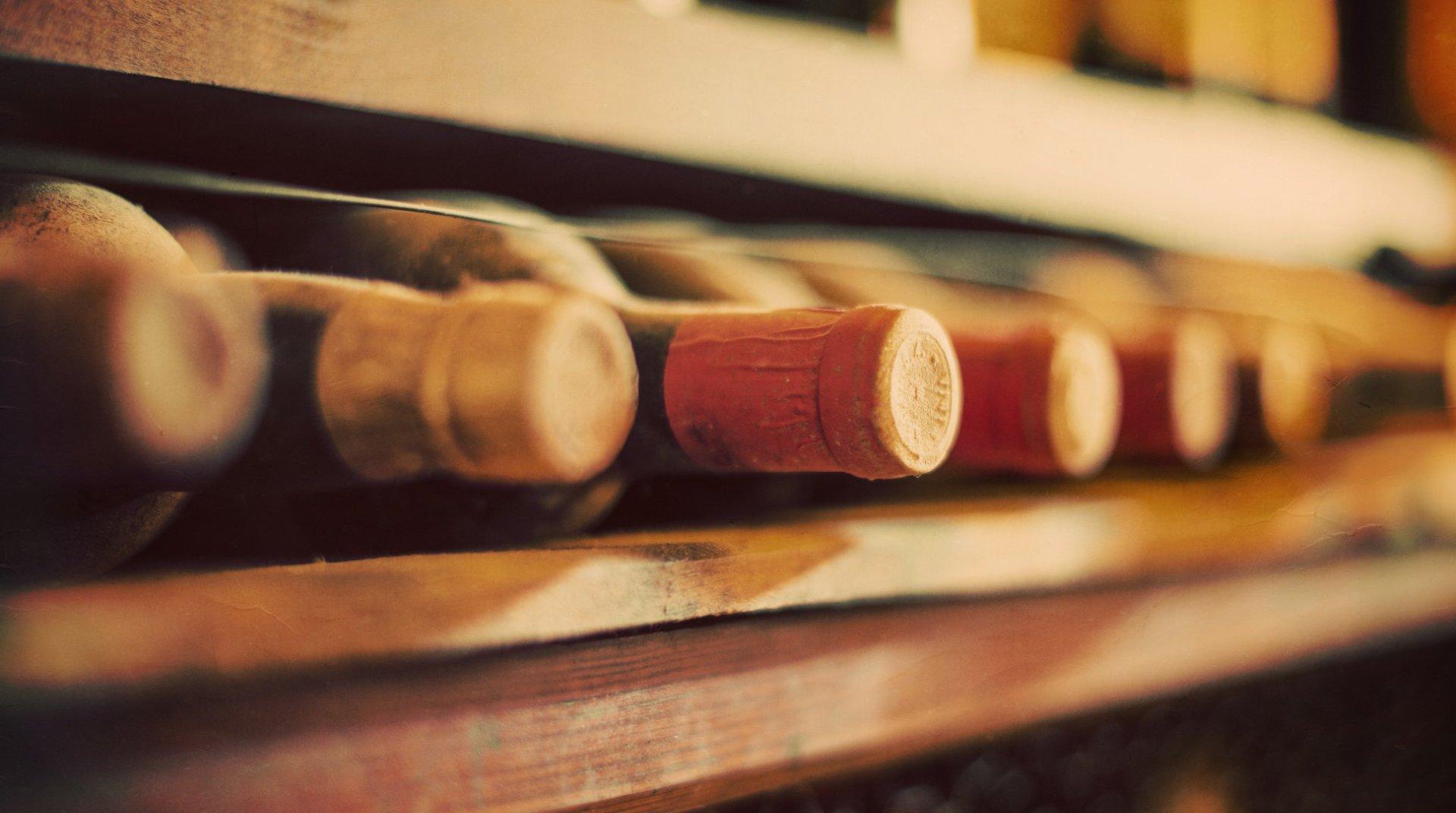 Bottles of wine on a wooden shelf