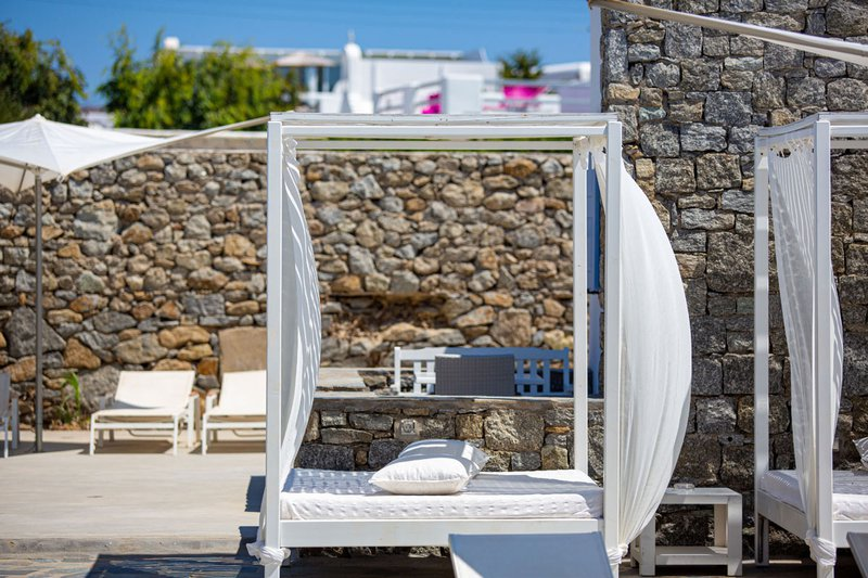 The outdoors beds and sunbeds by the pool