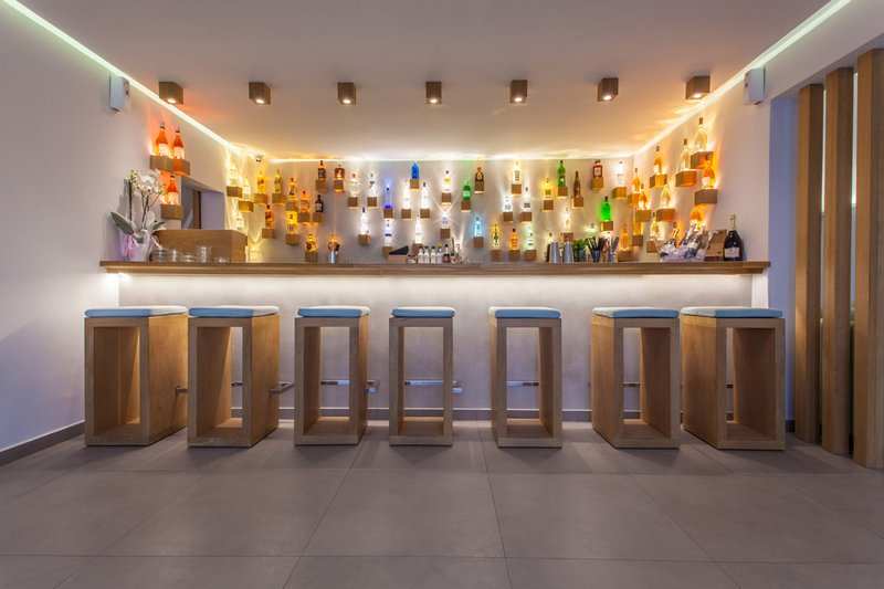 The bar of the resort, with the drinks and the chairs