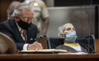 Robert Durst, seated with attorney Dick DeGuerin, is sentenced to life without possibility of parole for the killing of Susan Berman Thursday, Oct. 14, 2021 at the Airport Courthouse in Los Angeles. New York real estate heir Robert Durst was sentenced Thursday to life in prison without chance of parole for the murder of his best friend more that two decades ago. (Myung J. Chung/Los Angeles Times via AP, Pool)
