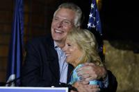 First lady Jill Biden, right, gets a hug from Democratic gubernatorial candidate Terry McAuliffe during a rally in Richmond, Va., Friday, Oct. 15, 2021. McAuliffe will face Republican Glenn Youngkin in the November election. (AP Photo/Steve Helber)