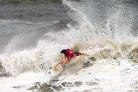 South Africa's Bianca Buitendag maneuvers on a wave during the semifinals of women's surfing competition at the 2020 Summer Olympics, Tuesday, July 27, 2021, at Tsurigasaki beach in Ichinomiya, Japan. (AP Photo/Francisco Seco)