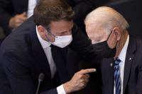 """FILE - In this June 14, 2021 file photo, U.S. President Joe Biden, right, speaks with French President Emmanuel Macron during a plenary session during a NATO summit at NATO headquarters in Brussels. French President Emmanuel Macron expects """"clarifications and clear commitments"""" from President Joe Biden in a call to be held later on Wednesday to address the submarines' dispute, Macron's office said. (Brendan Smialowski, Pool via AP, File)"""