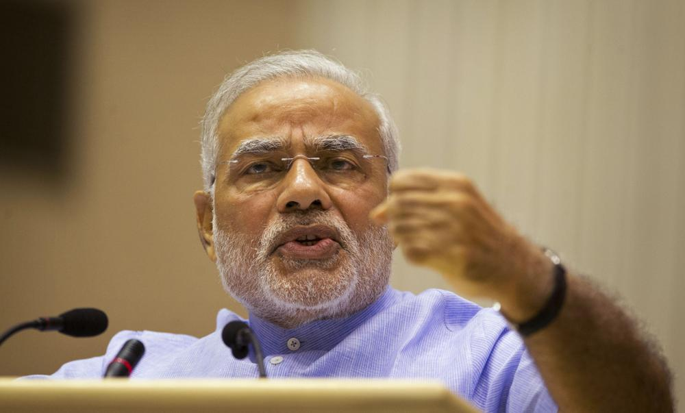 """In this Aug. 28, 2014 file photo, Indian Prime Minister Narendra Modi speaks at the launch of a campaign aimed at opening millions of bank accounts for poor Indians in New Delhi, India. India's new social media regulations is at the heart of a standoff that puts digital platforms like Twitter and Facebook under direct government oversight. The new rules, in the works for years and announced in February 2021, apply to social media companies, streaming platforms and digital news publishers. The new rules make it easier for the government to order social media platforms with over 5 million users to take down content that is deemed unlawful. Critics say Modi's Hindu nationalist government is imposing what they call a climate of """"digital authoritarianism."""""""